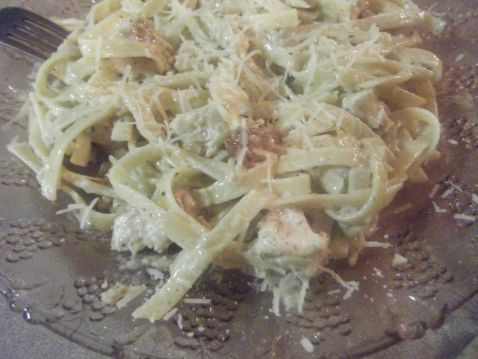 Chicken with a Creamy White Wine and Garlic Sauce Over Fettuccine