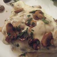 Chicken Smothered With Mushrooms Spinach Mozzarella and White Wine